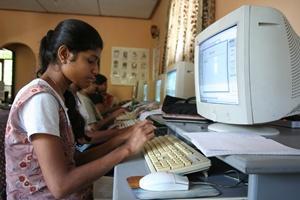 Sri Lankan girl and computer