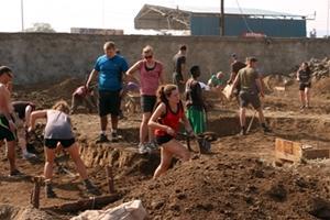 Group of volunteers at a building site in Kenya, Africa