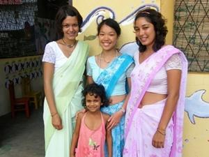 Gap year volunteers wearing traditional clothing on a project in Sri Lanka