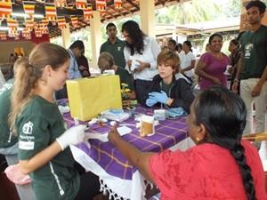 Volunteers with patients in a medical project in Sri Lanka