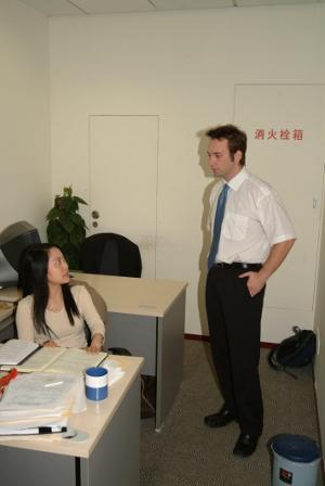 Male volunteer at law firm office in China