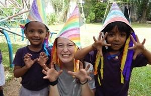 Projects Abroad Care & Community volunteer plays with Sri Lankan children in Asia.