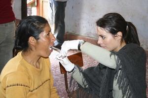Volunteer practicing dentistry